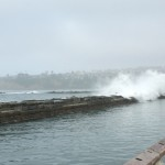 Waves crashing over the breaker.